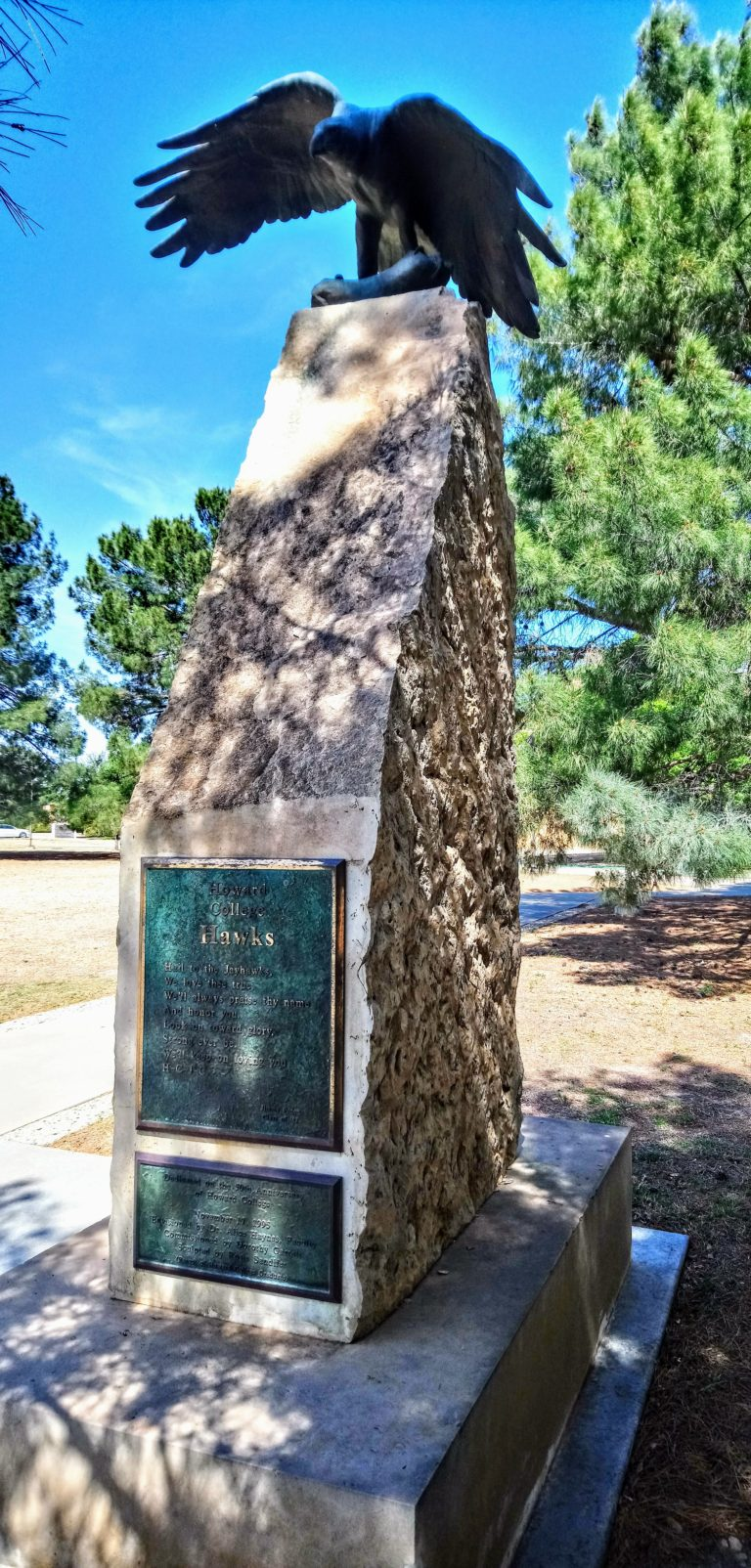 Stone time capsule with sculpture of hawk on Big Spring campus